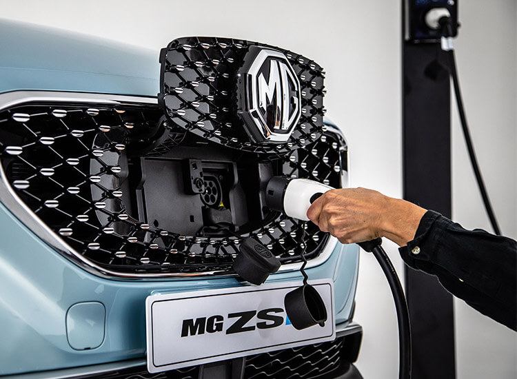 MG ZS EV charging cable being plugged into the front